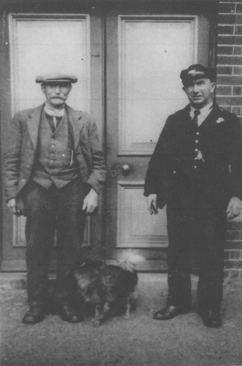 Elijah Coe and father Tom outside the station
